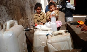 Yemeni children wait to fill their containers with drinking water in Sana'a