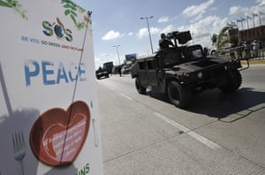 Week in Cancun COP16: Soldiers lead a convoy of armoured personnel carriers in Cancun
