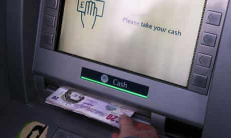 Cash being withdrawn from a bank ATM or cash machine