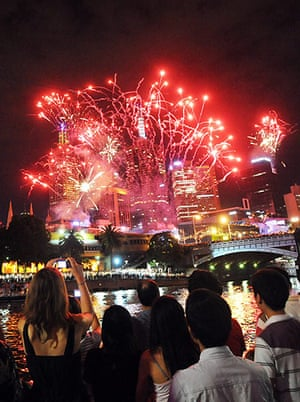 New Year Celebrations: Melbourne, Australia: Revellers watch the firework display over the city