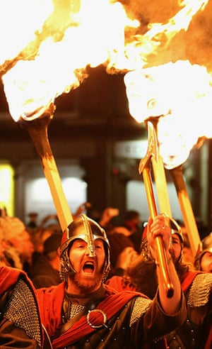 New Year Celebrations: Edinburgh, Scotland: Men dressed as Vikings lead the torchlight procession