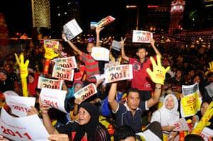 New Years Celebrations: Kuala Lumpur, Malaysia: Malaysian people hold placards