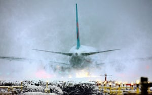 24 Hours: A plane throws up snow as it prepares for takeoff at Gatwick Airport