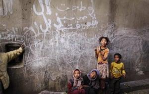 24 Hours: Yemeni children listen to a woman, unseen, talking to them