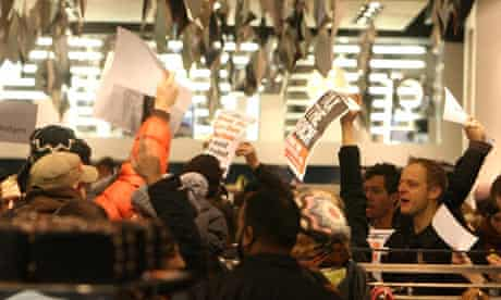Demonstrators from the UK Uncut group inside Topshop on Oxford Street, central London