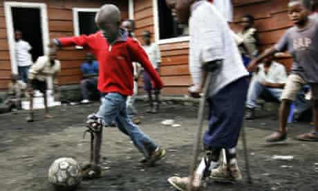 Children with polio play soccer in Goma
