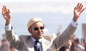 Moroccan King Mohammed VI waves to the crowd as he tours in Dakhla, Western Sahara, in November 2001