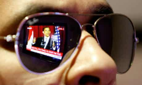 A Saudi man in the capital, Riyadh, watches a TV broadcast of a speech by Barack Obama