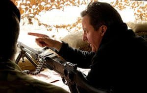 Cameron in Afghanistan : David Cameron surveys a nearby village from the top of a sangar observation
