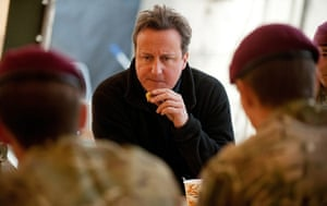 Cameron in Afghanistan : David Cameron speaks with soldiers from 2 Para in the cookhouse