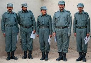 Cameron in Afghanistan : Afghan Graduate Patrol men stand in a line after meeting David Cameron