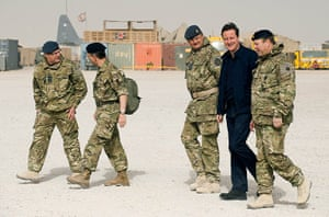 Cameron in Afghanistan : David Cameron smiles as he arrives at patrol base 2