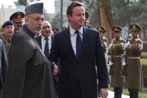 Cameron in Afghanistan : David Cameron shakes hands with Afghanistan's President Hamid Karzai