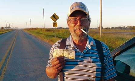 Pass the bucks: Ray Holman with $10 note