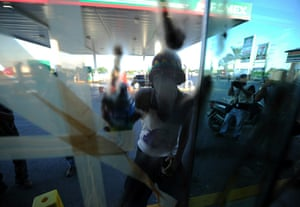 COP16 updates: An activist sprays the window of a fast food restaurant in Cancún