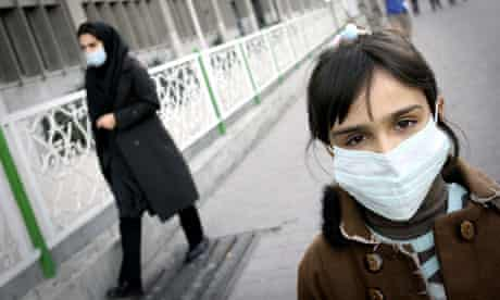 An Iranian girl wears a protective mask against air pollution in Tehran, Iran.