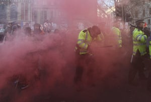 student protest update: Demonstrators and police officers surrounded by smoke in Parliament Square