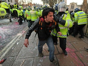 student protest update: A protestor is detained by police following clashes in London