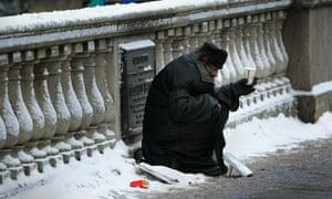 Homeless man in snow