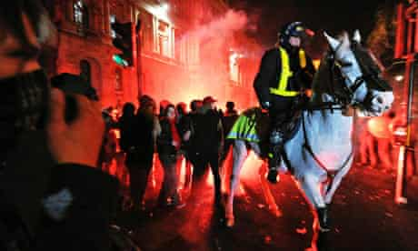 Mounted riot police clash with protesters