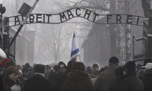 Visitors to Auschwitz pass beneath a replica of the Arbeit Macht Frei sign in January 2010.