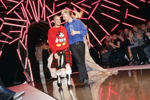 Alexander McQueen: 2007: Alexander McQueen walks the catwalk with Philip Treacy