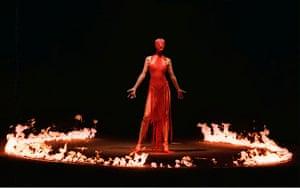 Alexander McQueen: 1998: A model stands among a ring of fire Alexander McQueen