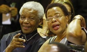 Nelson Mandela with his wife, Graça Machel, in parliament.