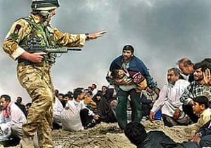 Photoshop at 20: Photoshop image of British soldier directing civilians from Iraqi fire