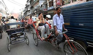 A woman travels in a rickshaw in New Delhi, India