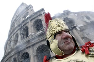 snow in Rome: A man dressed as an ancient Roman