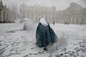 snow in Rome: A nun walks in St. Peter's square