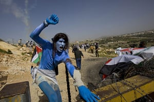 West Bank demonstration: A demonstrator dressed as a figure from the movie Avatar shouts slogans