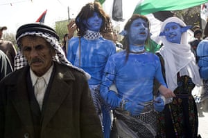 West Bank demonstration: Demonstrators dressed as Na'vi characters from the film Avatar