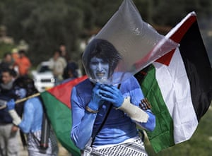 West Bank demonstration: A protester dressed as a character from the movie Avatar