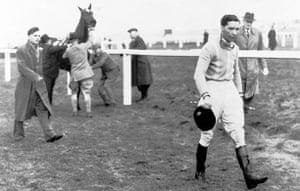 Dick Francis: 1956: Jockey Dick Francis walks away in despair during the Grand National