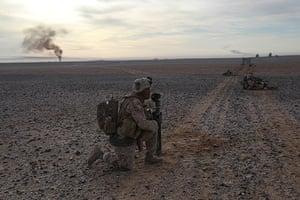 Operation Moshtarak : Smoke rises from a hellfire missile strike outside Marjah