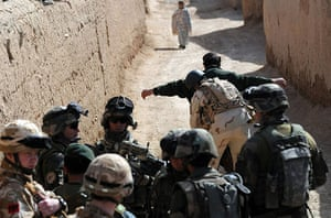 Operation Moshtarak : Afghan security personnel search a man in Qari Saheb village