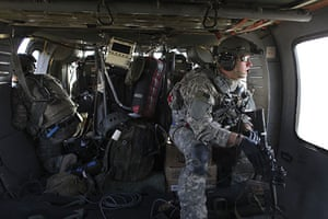 Operation Moshtarak : US Army flight medic flies on a pickup mission over Marjah