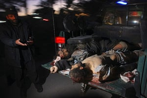 Operation Moshtarak : Dead bodies of Taliban militants on the back of a police vehicle