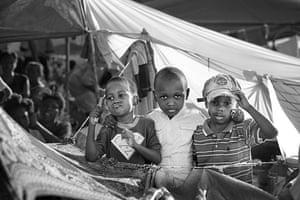 Haiti Exhibit Sale: Families who set temporary shelters Petion Ville,  Port-Au-Prince
