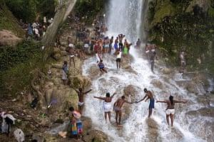 Haiti Exhibit Sale: Pilgrims bathe and pray in the waterfall at Saut D'eau, Haiti