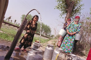 Tajikistan Climate: Kulyab - water flowing from a tap into an empty milk churn