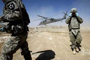 Operation Mshtarak: A US Combat medic by a Black Hawk helicopter evacuating a wounded boy