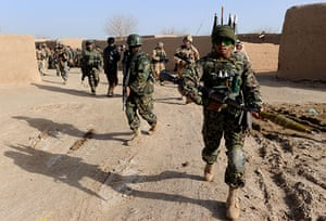 Operation Mshtarak: Afghan National Army and International forces patrol in Qari Saheb village