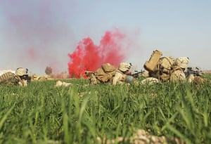 Operation Mshtarak: US Marines take cover in a poppy field during a firefight with Taliban