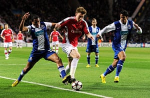Wed Champions League: Alvaro Pereira and Bruno Alves attempt to stop Arsenal's Nicklas Bendtner