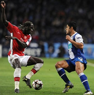 Wed Champions League: Hulk keeps an eye on Bacary Sagna as he tries to go past the Porto forward