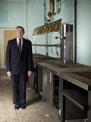 Lewis's fifth floor: Man posing in empty canteen kitchen