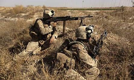 US marines in a poppy farmland area north-east of Marjah.